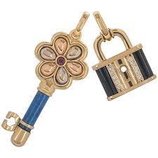 gold and diamond lock and key pendant