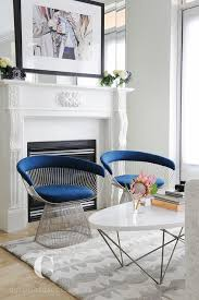 bold blue velvet chairs with oval tail table