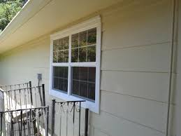 exterior view of new window installed with trim