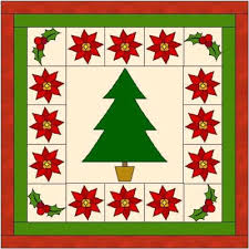 Christmas Blocks & Above is a quilt made up of 3 blocks. There are no instructions for this  quilt as I have made it to inspire you. Adamdwight.com