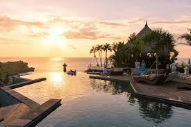 infinity pool night. In The Cliff-edge Infinity Pool Of La Joya Biu Biu, While Gazing Out At Awe-inspiring Ocean Views, Especially During Sunset When World Is Bathed Night