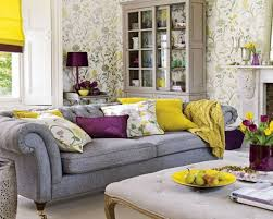 Yellow Living Room Decor Living Room White Shelves Gray Recliners Gray Sofa Brown Chairs