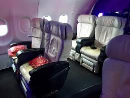 the white leather recliner seats have 55 inches of seat pitch excellent recline and a footrest it reminded me of an old international business class