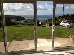 collection in sliding patio doors white porch with square leaded top openers and hipped tiled roof