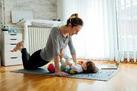 popsugar is hiring for these work from home writing jobs now mother exercise her baby at home