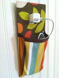 iPhone itouch Hanging Charging Station in orange, brown, yellow green  turquoise white floral and stripes