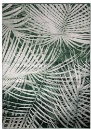 green palm leaf rug by ella james notonthehighstreet
