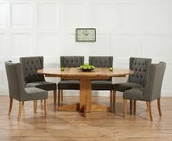 elegant dorchester 120cm solid oak round extending dining table with safia fabric chairs round oak