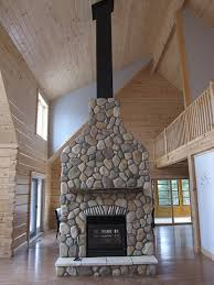 rsf oracle double sided wood burning fireplace with cultured stone