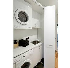 no room for a laundry room check out these clever space saving arrangements