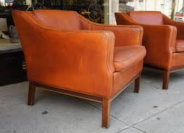 mid century modern a pair of danish modern leather upholstered club chairs for