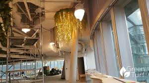 pillar concealed with artificial green wall and lights