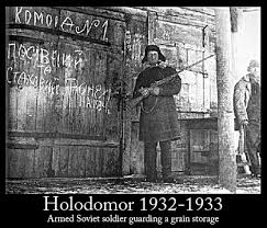 popular press articles on holodomor ukrainian famine genocide of armed soviet ier guarding a grain storage during the ukrainian famine genocide perpetrated by the opinions and essays