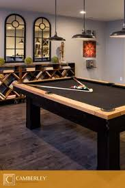 pool table lights. Rustic Farmhouse Style Light Fixtures Hang Above A Black-felt Pool Table In The Hamilton Lights