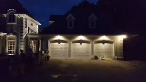 above is an example of outdoor lighting customization as you can see the garage is completely illuminated by way of elegant lighting