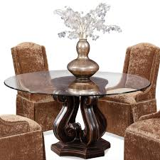 furniture round glass dining table with dark brown wooden carving bases connected by brown fabric