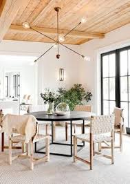 feature see inside the polished htons home that left our editors schless round dining tablewoven