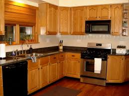 light wood kitchen cabinets with black countertops cabinet