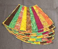 i was intrigued by these unusual quilt as you go fan shaped place mats in fast furious family by gudrun erla