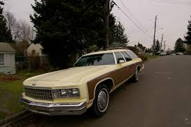 OLD PARKED CARS.: 1976 Chevrolet Caprice Estate Wagon.