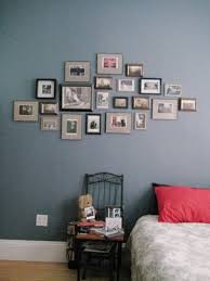 hanging postcards of some of favorite artists pictures of family friends and inspiration as