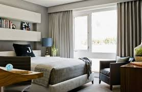 View in gallery Drapery and bedding fabric add to the elegant color scheme  of the boys' bedroom