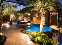 Swimming Pool And Spa With Outdoor Kitchen Bar And Waterfalls - Outdoor kitchen designs with pool