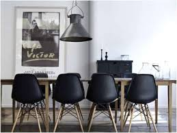 modern furniture dining table. Modern Black Chairs Accentuate A Light-colored Wooden Table Furniture Dining