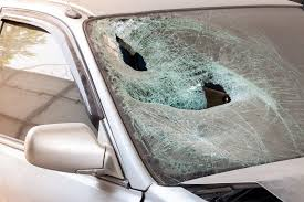 crashed car with broken windshield glass transportation accident