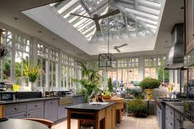 Greenhouse-Inspired Kitchens Lots of Windows and Light. Weathered wood  cabinets and modern metal and glass.