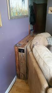 low cost wooden pallet behind sofa table
