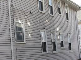 home inspector donald lovering shows a home with badly melted vinyl siding along with several concentrated reflections from the neighboring windows
