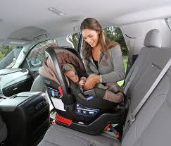 mother sets infant car seat