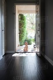 Image Stock View Through Entrance Hall Of Baby Boy Sitting Outside At Open Front Door Looking At Camera Open Mouthed Alamy View Through Entrance Hall Of Baby Boy Sitting Outside At Open Front