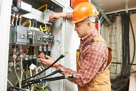 electrical contractor buffalo ny electric panels wiring expert checking the circuit in a commercial unit