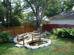 small garden bridges i want a pond with flowers around it and a little bridge over