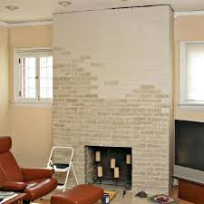 painted brick fireplace before and after partially painted brick fireplace painted brick fireplace