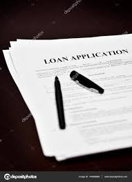 doent loan or contract on a desk with a black pen photo by eric1513