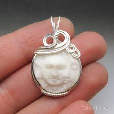 moon face carved bone bovine cameo sterling silver wire wrapped pendant kim s jewels