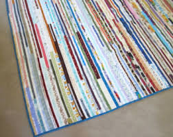 Jelly Roll Race Quilts curated by Quiltsy Team on Etsy & Scrappy Quilt