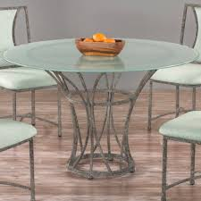 oceanside round glass dining table by wesley allen shown in a textured blue finish with