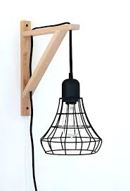 hanging light ikea cage light sconce a clever idea using the threshold industrial plug in pendant