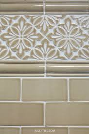 shown above cobham handmade tile border with scalloped chair rail trim handmade subway tile all in light brown watercolor