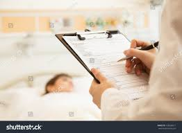 Close Doctor Writing On Medical Chart Stock Photo (Royalty Free ...
