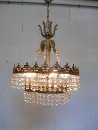 crystal chandelier with copper mounting and fleur de lis and acanthus leaf decor ca
