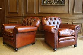 oned back antique pair of leather club chairs