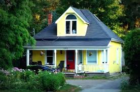 warm red door cote house plans 7 yellow houses with doors on green shutters