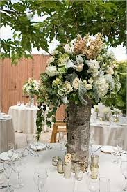 tall birch tree vases as table centerpieces