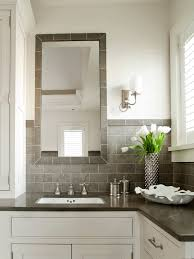 bathroom and kitchen tile. grey tile bathroom, contemporary, bathroom,white and gray bathroom with white walls paired subway backsplash. mirrors over kitchen e