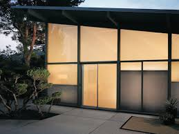 duette architella honeycomb shades on a sliding glass door outside view for at